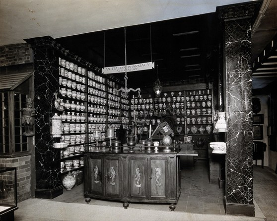 Black and white photograph of a reconstruction of a seventeenth century Italian pharmacy