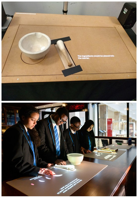 Colour photographs of an interactive pharmacy counter with pupils exploring it