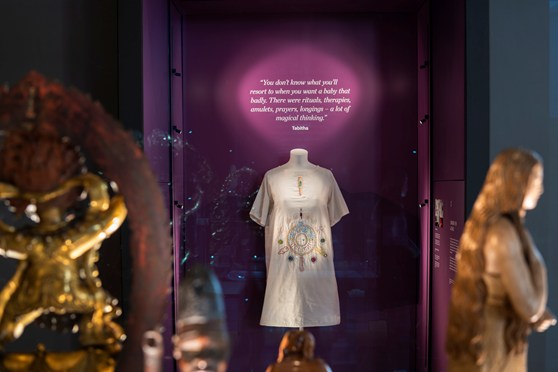 Colour photograph of a fertility dress on display in the Medicine Galleries