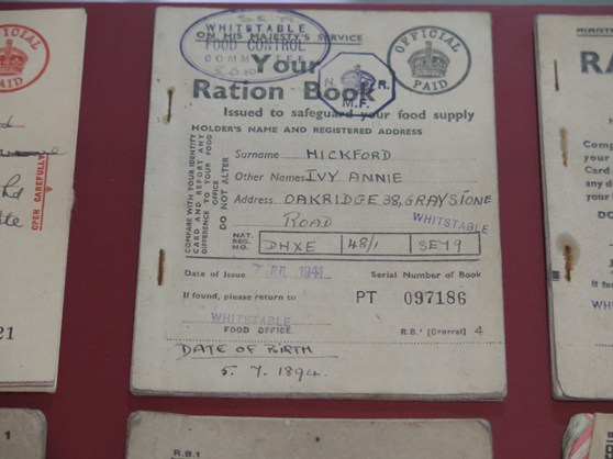 Colour photograph of World War Two ration books on display