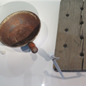 Colour photograph of historical bathing implements on display